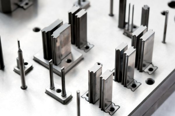 Series of components machined through Wire Electro-Discharge Machining.